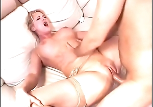 Licking the blonde milf'_s pussy on the top of the couch