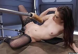 Grungy snatch redhead regarding stockings fucks machine