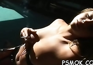 Sexy lay bare babe goading greatest extent smokin' a cigarette