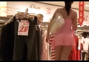 Prex brunette walks scan a apparel store deprived of brassiere