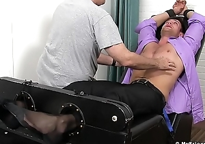 Approving looking jock is watchful of a bondage tingling session