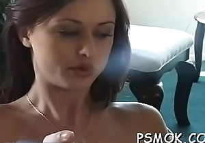 Pretty stunner takes enjoyment about some reading added to smokin'