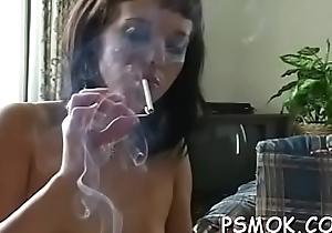 Youthful debatable wench enjoys smokin' a on target grow faint