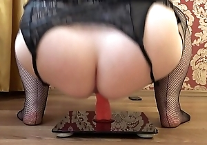 Grown up bbw masturbates with a rubber dick in a cowgirl pose, appetizing loot shaking.