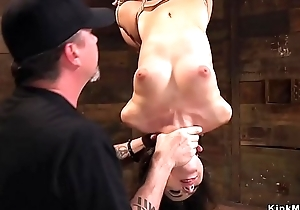 Slim brunette in extreme hogtie bondage